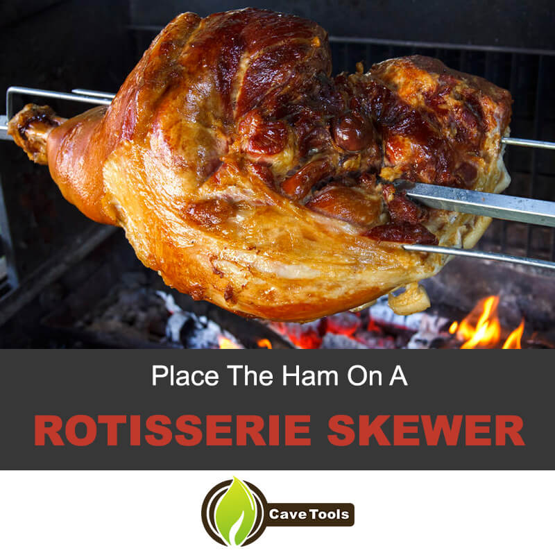 Place the ham on a rotisserie skewer
